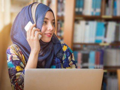 Muslim woman on computer