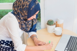 Muslim woman working from home, flexible working featured