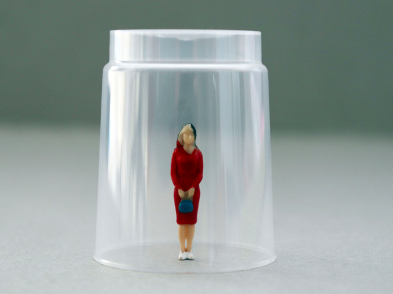 woman under a glass, breaking glass ceiling