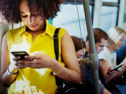 young woman on her phone commuting, career advice
