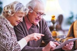 elderly couple with a tablet, coronavirus, technology