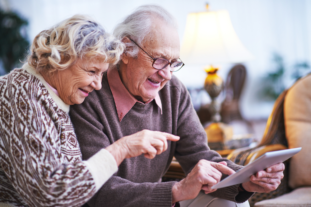 elderly couple with a tablet, coronavirus, technology