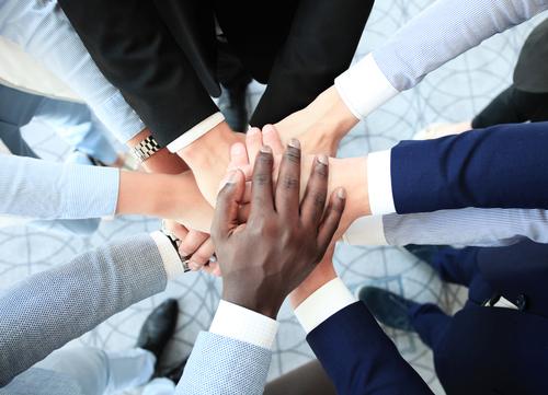 Team holding hands, diversity