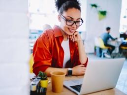 woman watching a webinar, virtual