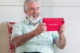 Elderly man using Grandpad, technology