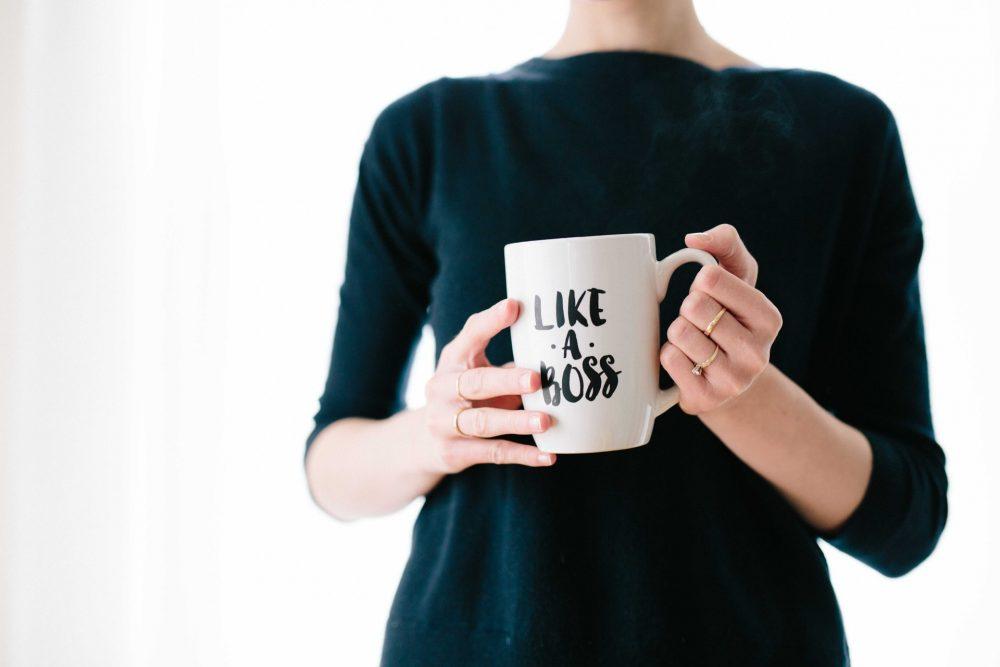 woman holding a like a boss mug, career development