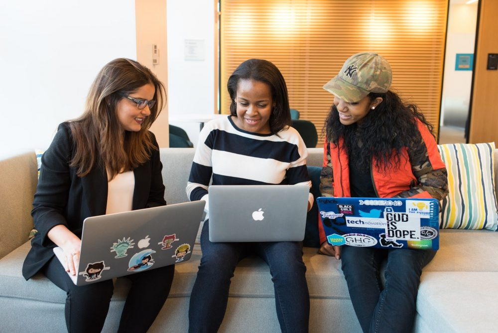 three women in tech working on laptops, gender diversity
