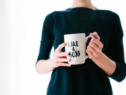 woman holding a like a boss mug, career development