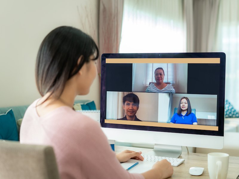 woman remote working on video conference