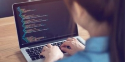 Woman learning to code featured