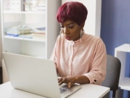 woman working on laptop featured
