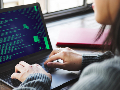 woman coding on laptop, Code First Girls