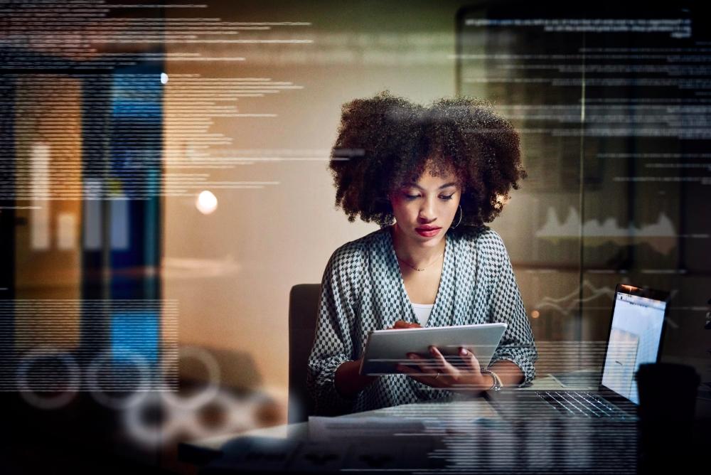 woman using tablet, women in tech, CMI