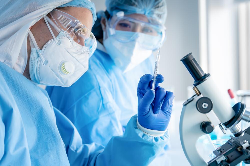 coronavirus covid-19 vaccine in hands of pharmacuetical bio research scientist, biohealth